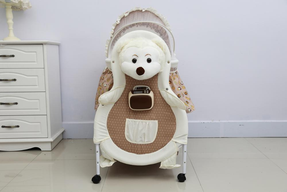 Multifunctional crib cradle newborn baby electric swing music baby electric rocking chair shaker
