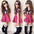 Los niños ropa de estilo informal de verano del bebé muchachas de los muchachos de la Camiseta + Falda traje de la ropa de los niños