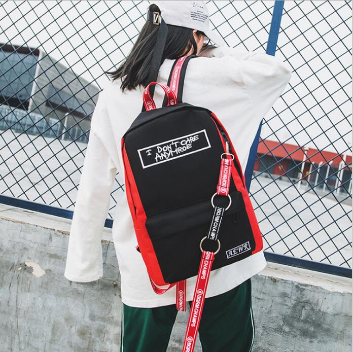 Casual backpack unisex backpack Korean version of the new letter printing ribbon college wind simple student bagCasual backpack unisex backpack Korean version of the new letter printing ribbon college wind simple student bag