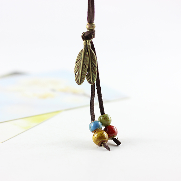 product Simple National Style 100% Handmade Creative Ceramic Leather Cord Necklace Pendant Feather Adorn Article for Women