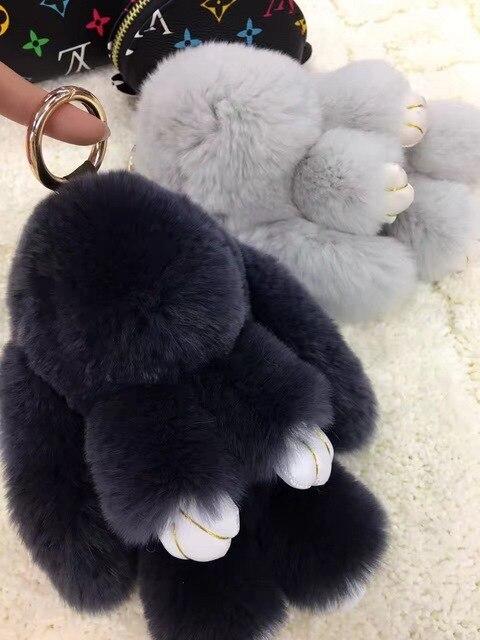 Черный Pom poms Кролик Куклы брелки Женщины Девушки Сумка шарм Настоящее Мех Кролика брелок Автомобиль Брелки Сумка Кошелек Подвески подвески