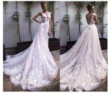 ローリー王女のウェディングドレスレースアップリケ花 A ラインチュール着脱式トレイン自由奔放に生きるのウェディングドレスの花嫁ドレス 2019