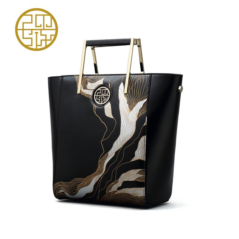 2017 Pmsix new fashion carving art handbag handbag Chinese wind big bag simple fashion leather bag
