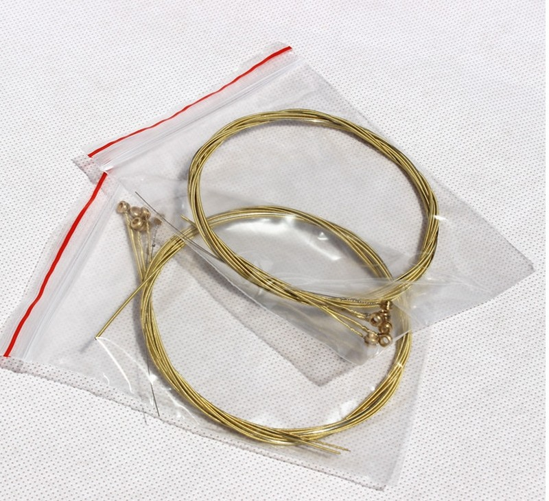 2sets lot high quality yellow brass acoustic guitar strings guitar parts factory wholesale. Black Bedroom Furniture Sets. Home Design Ideas