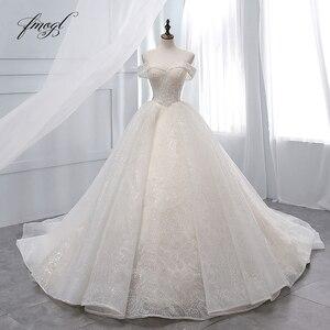 Image 1 - Fmogl Vestido דה Noiva סירת צוואר כדור שמלת חתונת שמלות 2019 סקסי ללא משענת חרוזים קפלת רכבת תחרה בציר כלה שמלה