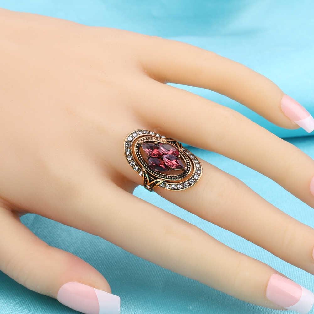 ファッション中空オーバルパターンピンククリスタルリングインドのホワイトラインストーンの結婚指輪ヴィンテージゴールドブルガリアジュエリー