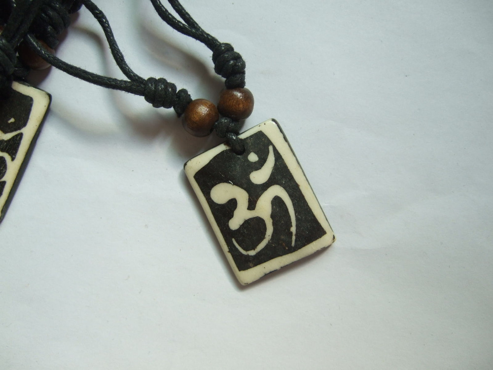 1pcs real tibet yak bone carved om ohm necklace aum symbol yoga 1pcs real tibet yak bone carved om ohm necklace aum symbol yoga pendant black wax cotton cord 2030mm in pendant necklaces from jewelry accessories on mozeypictures Image collections