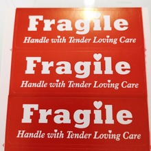 300pcs 76x25mm FRAGILE HANDLE ME WITH TENDER LOVING CARE label sticker for package protection, Item No. SS40