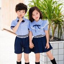 a7a4880e86d10 Académico de la Escuela de Verano uniformes trajes camiseta pantalones  cortos traje de falda niños niñas Kindergarten Junior los.