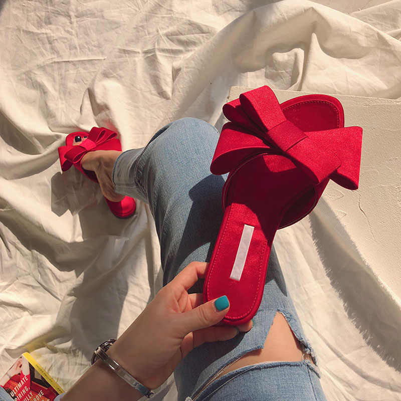 Wearing flat slippers women's shoes 2019 Korean version of the summer new large bow satin round head sandals Wild half slippers