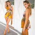 Super hermosa de color amarillo de impresión summer fairy falda backless del mono de encaje hueco siamés culottes
