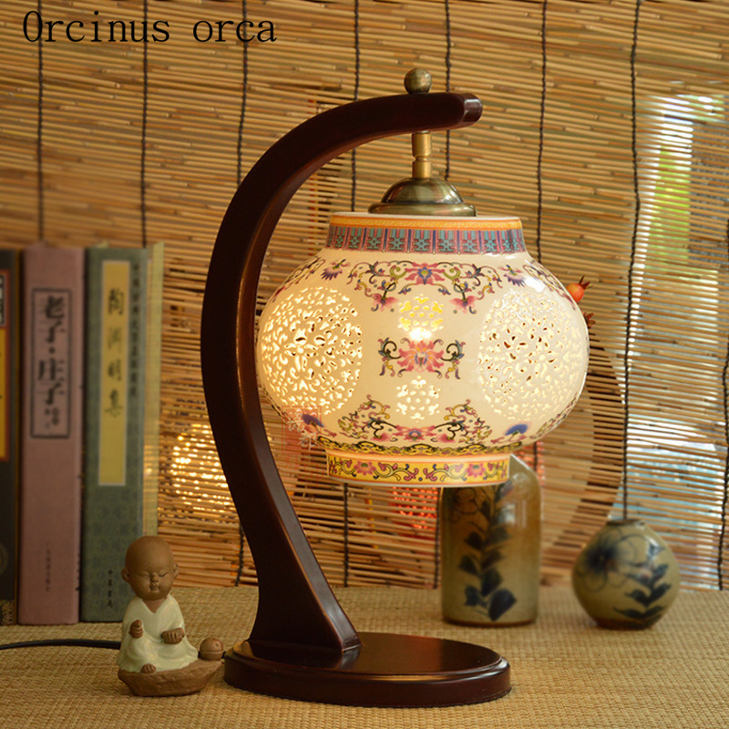 New Chinese classical hollow led ceramic table lamp bedroom bedside lamp American Pastoral creative solid wood desk lamp modern minimalist table lamp american creative wood iron lamp bedside lamp bedroom desk lamp