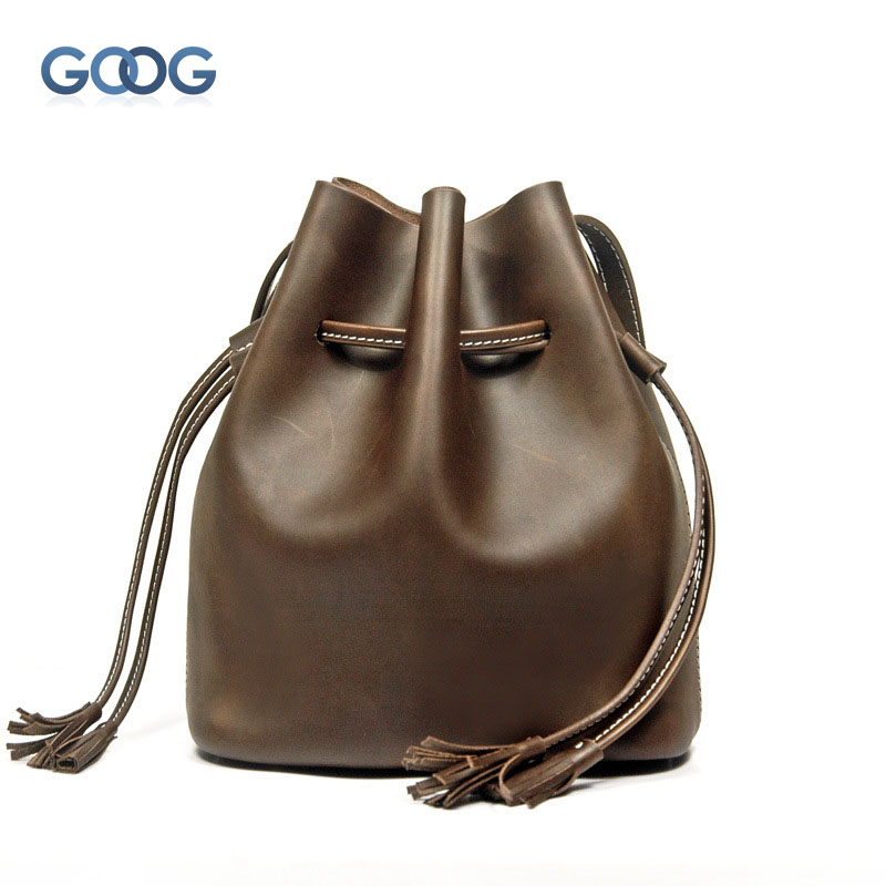 New retro bucket Messenger bag two layers of leather tassel ladies bag shoulder pumping with a solid color leather handbags pumping bucket bag rivet handbags mini bucket bag