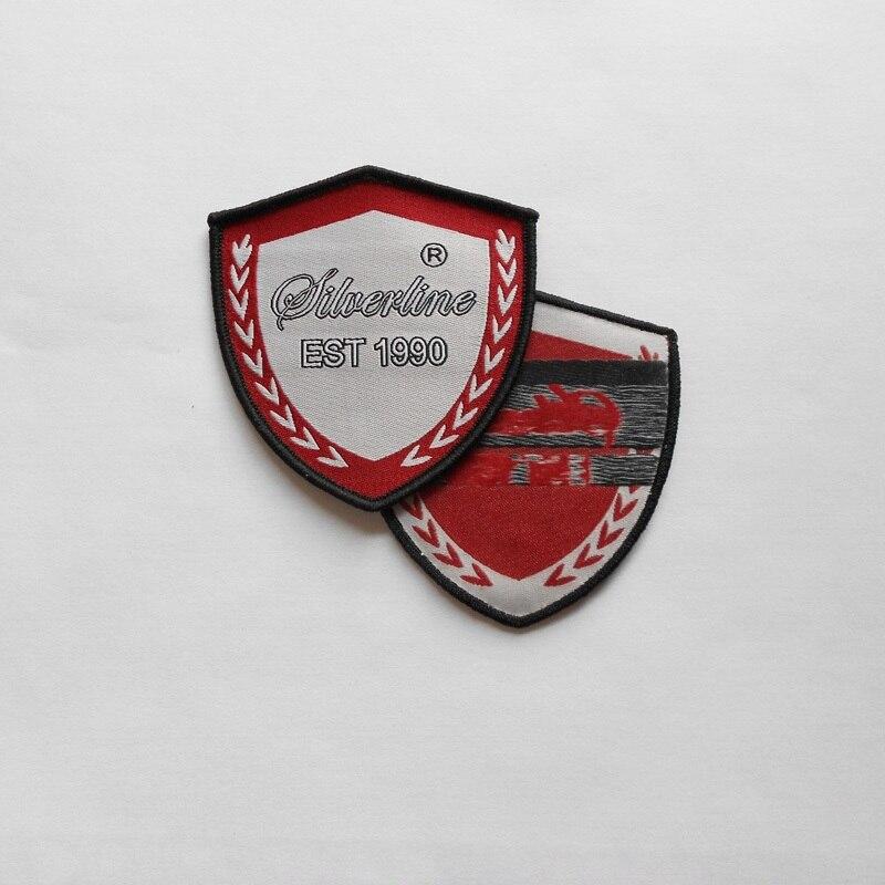 길쌈 된 기장에 주문을 받아서 만들어진 (1000pcs / pack) 의복 철, 아프리카 학교를위한 상표 로고를 가진 방패에 의하여 바느질되는 merrow 국경