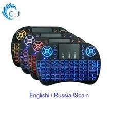 купить Wireless Keyboard Russian English Spain Version+2.4GHz +Li-ion Battery Air Mouse Touchpad Handheld for Android TV BOX Mini PC по цене 665.24 рублей