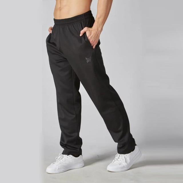 Nueva llegada jogging pantalones de entrenamiento de fútbol para hombres  mallas deportivas para correr gimnasio fitness 18003cd8e389d
