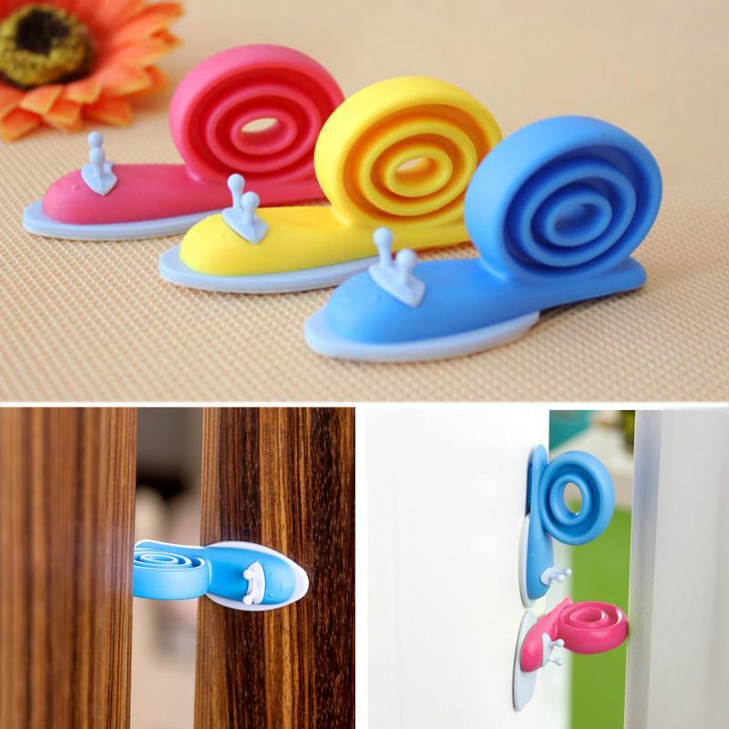 3Pcs/lot Soft Plastic Baby Home Safety Door Stopper Protector Children Safe Snail Shape Door Stops Baby Gate Corner Protector