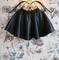 Free shipping 2015 super cool girls half-length skirt leather texture wild