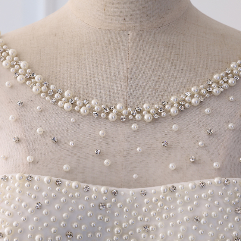 b8b454eea2cb Large quantity pearls china bridal gowns white illusion neckline cheap  wedding dresses imported china online store ball gown-in Wedding Dresses  from ...