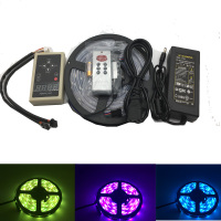 6803 IC Magic Dream Color RGB LED Ribbon 5050 30LED / m chasing lights + 133 program RF magic controller + power adapters