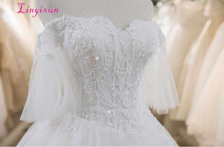 Последние Свадебные платья трапециевидной формы кружевные бисерные Аппликации сексуальная спина с шнуровкой очаровательные свадебные платья многоярусные юбки на заказ