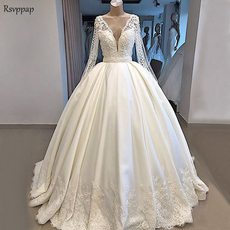 Luxury Wedding Dresses 2020 Sheer Lace Long Sleeve Sexy Nude Back V-neck Heavy Pearls Ball Gown White Satin Bridal Wedding Gowns