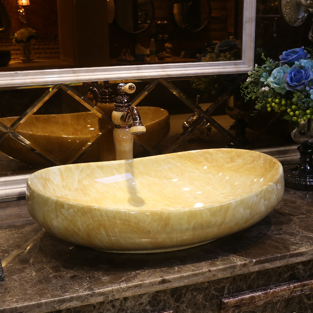 Artistic Porcelain Ceramic Wash Basin Bathroom Sink Bowl Oval Shape Imitation Marble Sinks