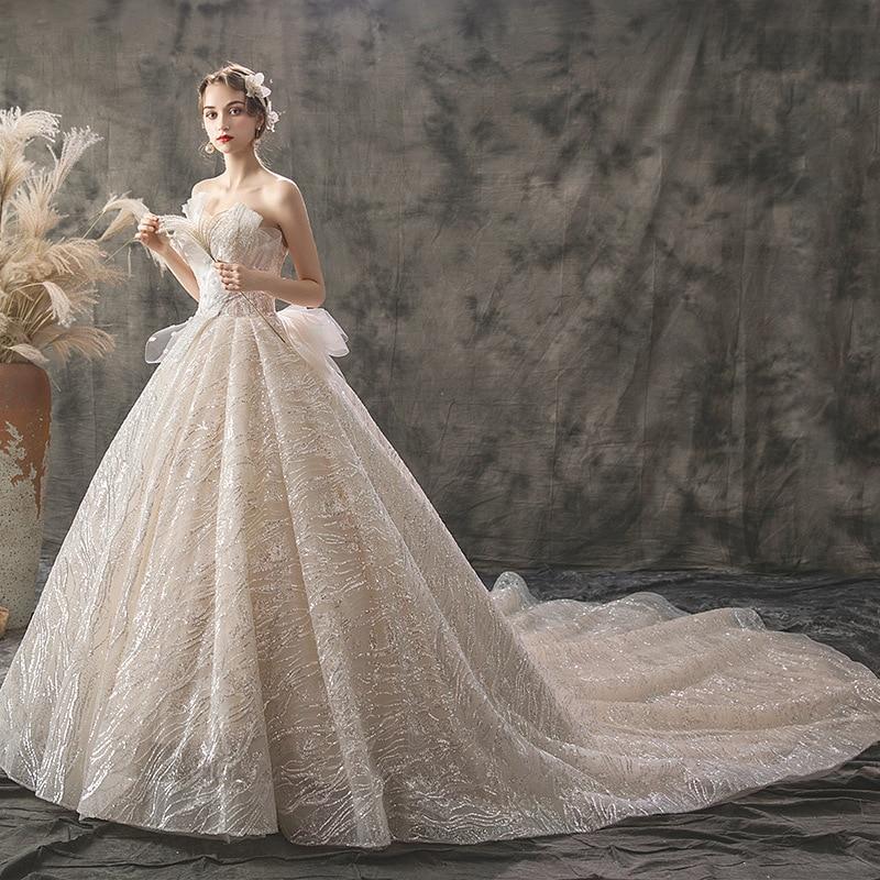 Image 4 - 2019 New Mrs Win Wedding Dress Sexy Strapless Ball Gown Luxury Bling Bling Beading Princess Vestido De Noiva Robe De Mariee F-in Wedding Dresses from Weddings & Events