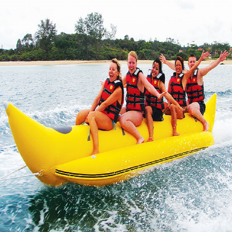 inflatable banana boat 5 people playing on the beach surf riding water game water toys summer necessary