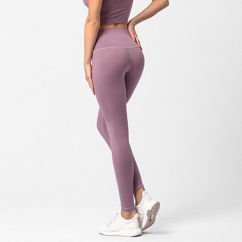 New hip slim-levantar terno de fitness esportes estanqueidade, calças de cintura alta e nove-minuto puro Calças de nylon Yoga