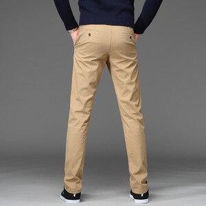 Image 4 - パンツ男性ビジネス綿のズボンストレッチ男弾性スリムフィットカジュアルビッグプラスサイズ 42 44 46 黒カーキ赤、青パンツ