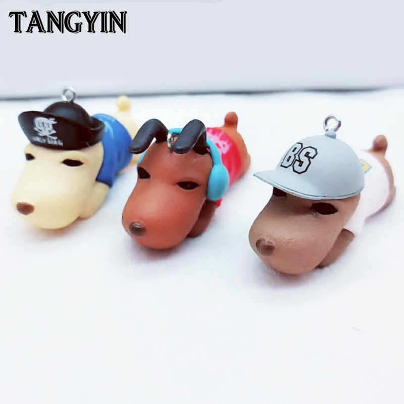 Cartoon Cute Dog Keychain del PVC Materiale Altamente Simulato Cane L'ascolto di musica Pirata Berretto Da Baseball Chiave Pendente del Sacchetto Della Catena Chiave Anello