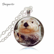 Buy otter pendant and get free shipping on aliexpress animal pendant neckalce sea otter picture jewelry glass cabochon gen pendants necklaces silver long chain statement aloadofball Image collections