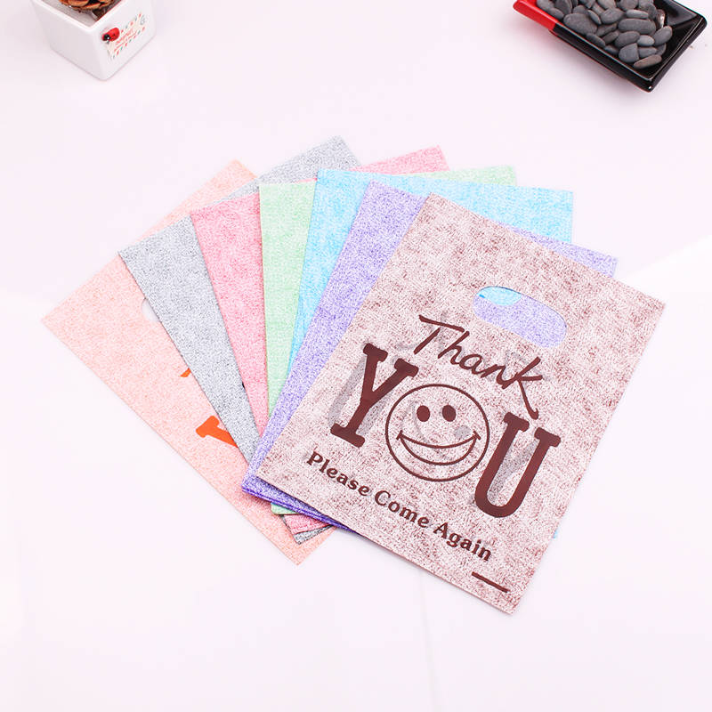 100pcs Jewelry Bags Plastic Shopping Bag with handle packaging gift bag Jewelry packing Bags Smile Thank You Style 15x20cm