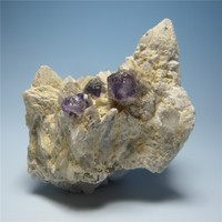 Mineral fluorite purplish fine spherical inclusions of quartz mineral ore samples symbiotic natural stones