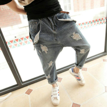 Personality hole jeans male plus size harem pants male low rise pants skinny pants hanging crotch