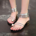 Free shipping 2016 summer new Women shoes fashion rhinestone and gold Roman sandals Women open toe sandals