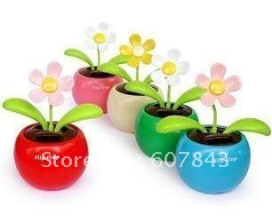 The car accessories solar flowers perplexed life sunflower solar shake leaves solar energy