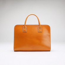 Handmade cowhide bag purse males's official package deal Commercial package deal high-grade purses