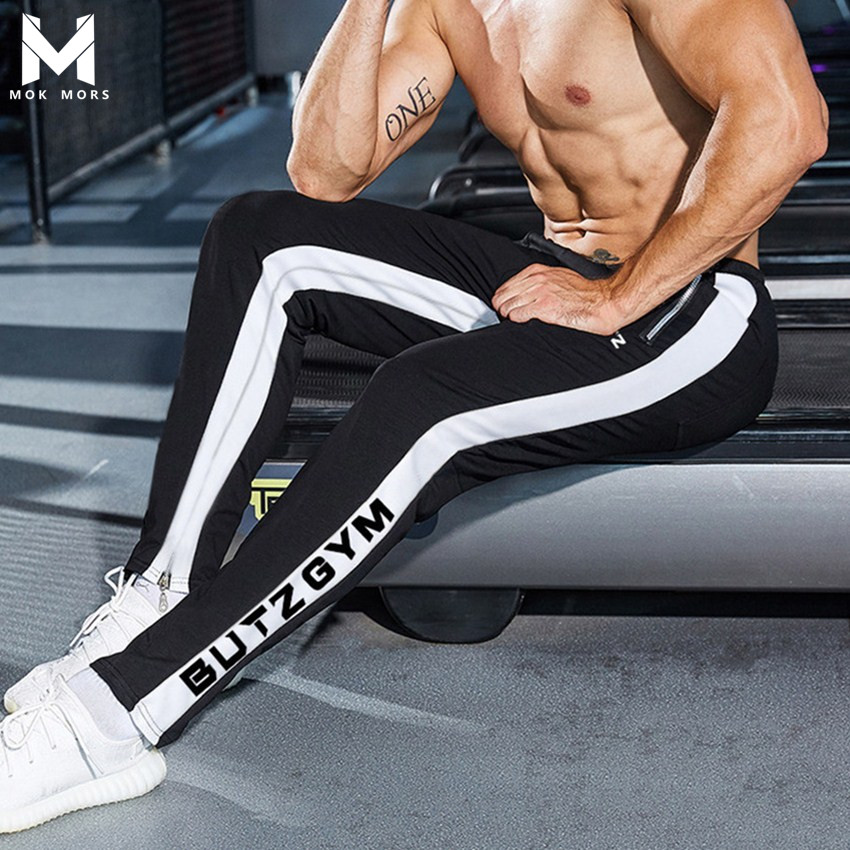Men's New Wild Low Waist Stitching BUTZ Letter Printing Trousers Men Fashion Brand Elastic Band Cotton Mens Pants