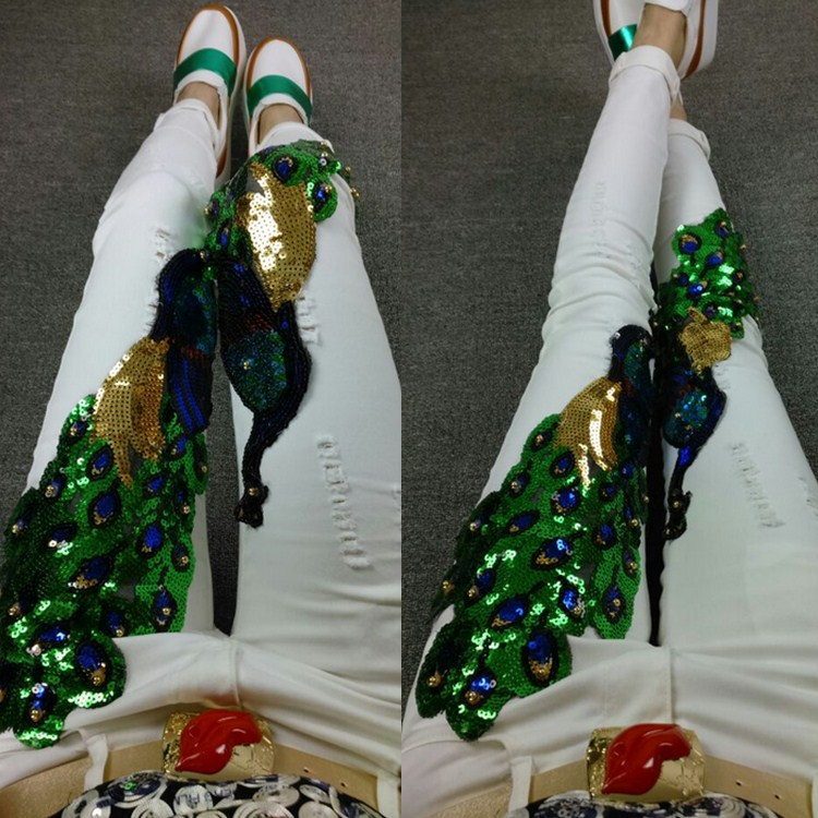 The European leg of the new spring and summer 2016 thin section of heavy peacock hole jeans pants all-match decoration