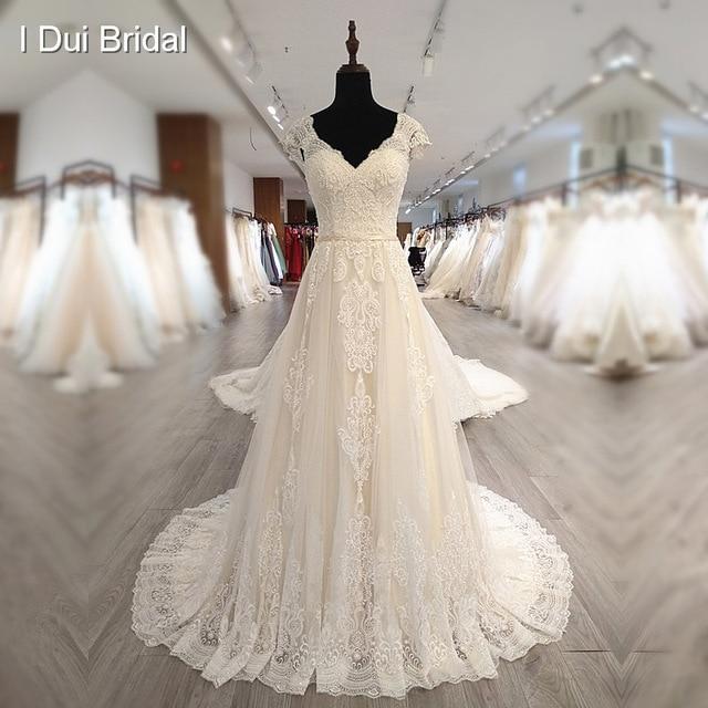 Boné manga v decote vestido de casamento com pérola de luxo frisado delicado laço nupcial vestido de alta qualidade fábrica feito sob encomenda