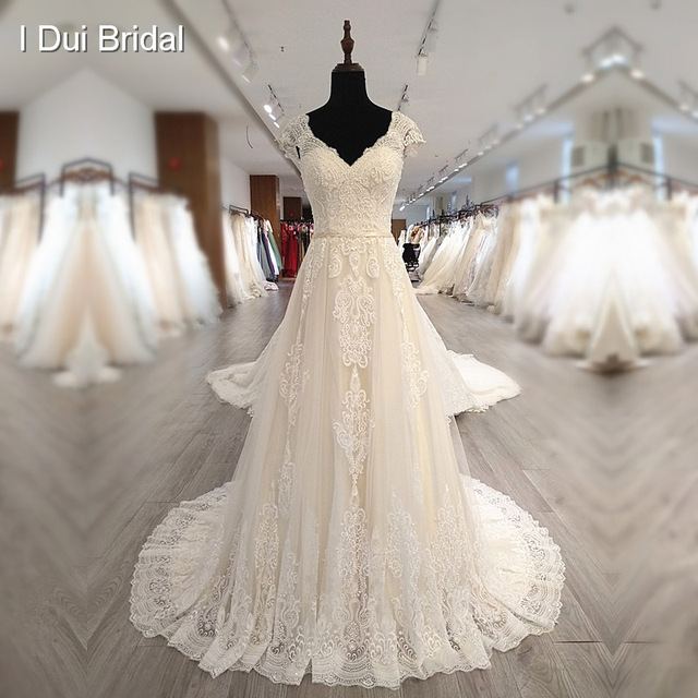 Cap Sleeve V Neckline Wedding Dress with Luxury Pearl Beaded Delicate Lace Bridal Gown High Quality Factory Custom Made