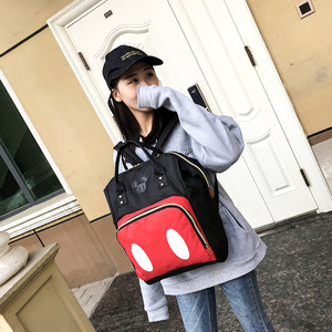Image 1 - 2019 new Disney backpack Mickey mouse Minnie travel couple canvas shoulder bag large mother bag wear resistant student bag