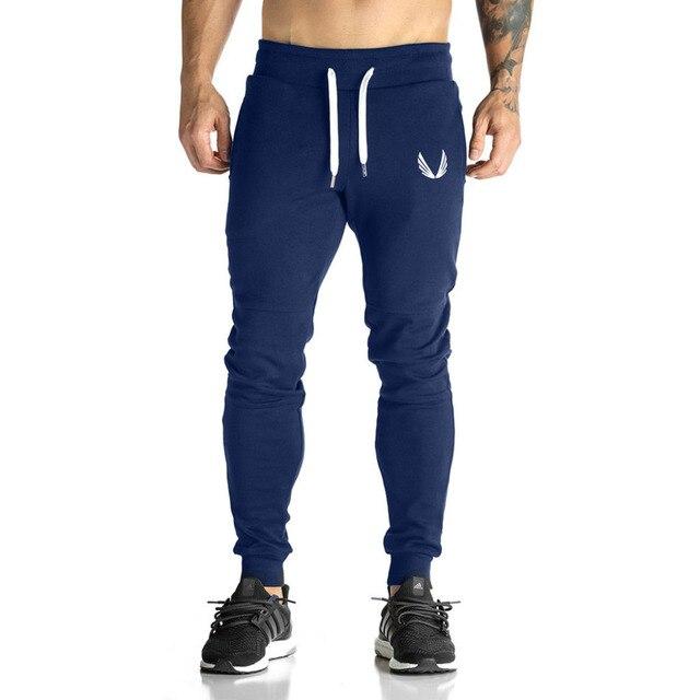 Осень Мужчины штаны Одежда брюки мужчины Случайные Длинные брюки Хлопок Плюс Размер Пота Эластичный Пояс Весна хип-хоп одежда