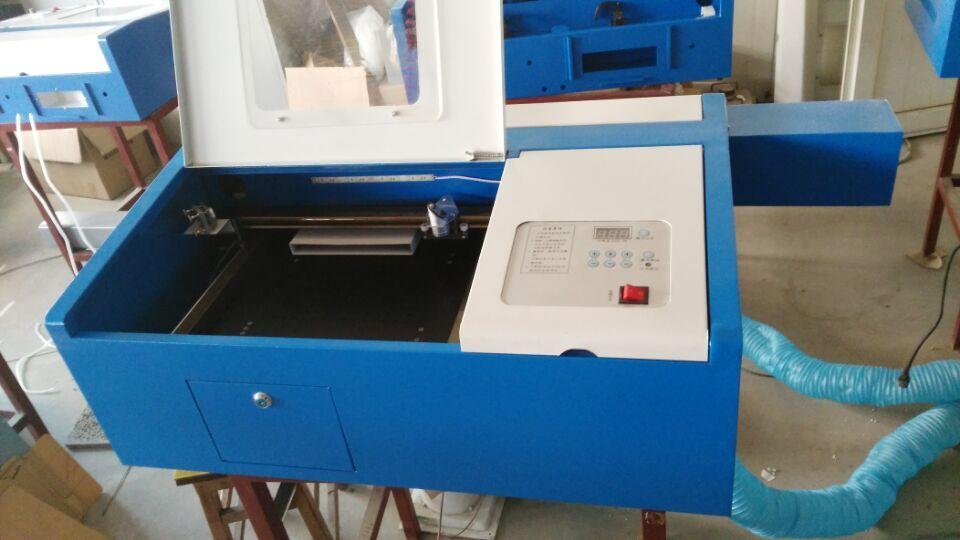 Mini prix bas CO2 laser gravure machine de découpe chine coupeur populaire