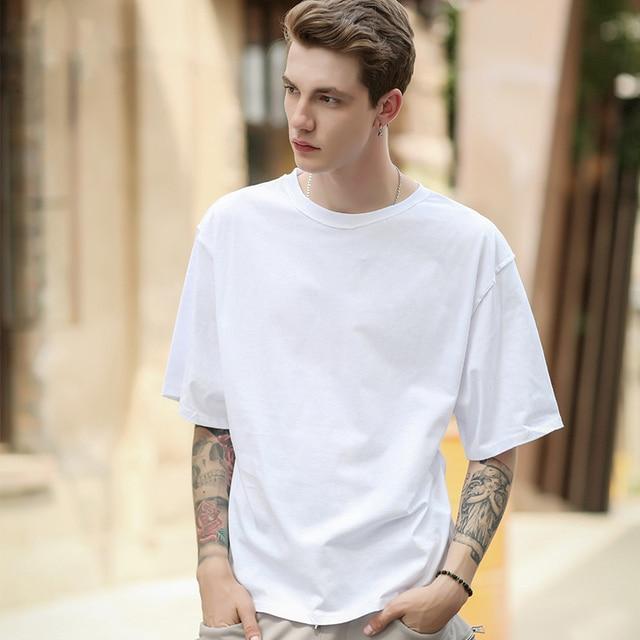 Negro y blanco Summer streetwear camiseta media manga o-cuello Kanye Tops  Camisetas Tees oversize cfc9d54089c