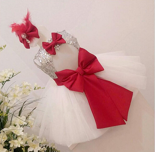 White tulle sleeveless flower girl dress silver sequin red bow keyhole back knee-length short baby first birthday dress