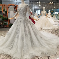 Stunning Sparkly Beaded Tulle Prom Gowns Elegant Long Sleeve Open Back Bridal Gowns Floor Length Formal Party Dress Custom Made
