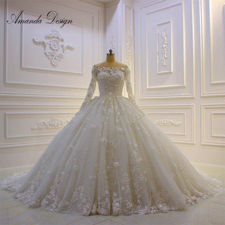 ed3bd5e80 Amanda diseño matrimonio hombro apliques de encaje de Puffy brillante boda  Vestido de manga larga